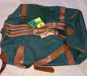 "2 DUFFLE BAGS. GREEN CANVAS AND BROWN LEATHER 20"" X 14"" X 12"". BROWN LEATHER TRAVELITE 18"" X 12""X12"""