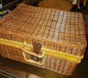 "WICKER PICNIC BASKET 10"" TALL X 20"" WIDE X 15"". TOP HANDLE LOOSE ON ONE SIDE"