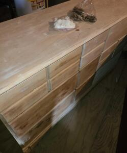 "9 DRAWER DRESSER STRIPPED TO BE REFINISHED. 2 SETS OF HANDLES. 33.25"" TALL X 54"" WIDE X 18"" DEEP."