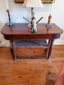 "Antique console table with casters. 47w x 24d x 28"" tall"