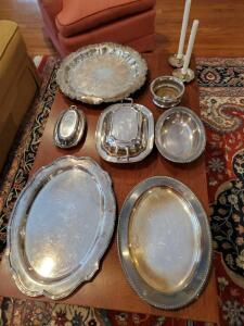 Wonderful grouping of silver plated serving items. Includes trays, covered dish, covered butter dish, candle holders, and more with bag.