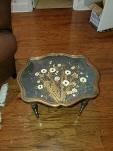 Lovely side table with pressed flowers under glass.