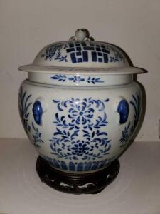 "Blue Asian influence pottery jar with lid. 9"" diameter, 9"" tall."