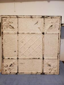 Antique tin ceiling tile made into a wall hanging. 23 x 23.