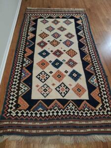 "Southwest influence dhurrie rug. 59""w x 112"" long."