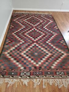 "Southwest influence dhurrie rug. 71""w x 112"" long."