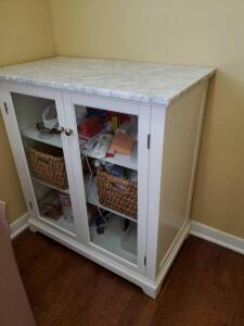 "Glass door cabinet with marble top. 33 x 18.5 x 36"" tall."
