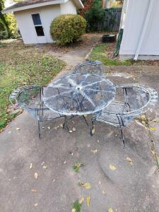 "Iron patio table and four chairs. Table is 42"" in diameter."