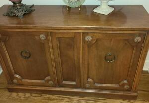 "WOODEN SIDE TABLE 30"" TALL X 48"" WIDE X 15"" DEEP. DOES NOT INCLUDE CONTENTS ON TOP OR INSIDE"