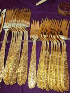 GOLDPLATED DINNER SERVICE. STEIF-JACCARD'S OF NASHVILLE, TN.