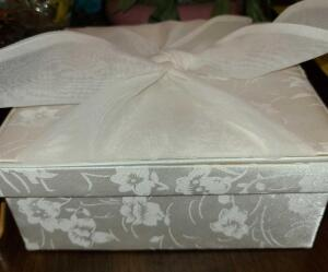 "NICE SATIN BOX FULL OF SMALL JEWELRY BOXES 1 IS PART WOOD WITH NICE CLASP. WHITE BOX IS 3"" DEEP X 8"""