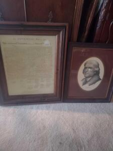 A nicely framed print of thomas Jefferson and a framed copy of the decoration of independence