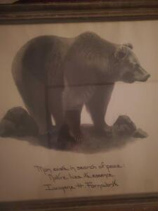 A framed print by great animal artist i.h. farnswoth of a bear and includes a saying