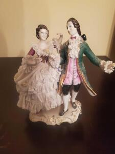 "A rare, splendid dresdin porcelain figurine 7"" tall, it's extremely difficult to find in this condition"