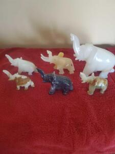 "8 marble/onyx elephants, the largest is 7"" tall, 7"" across"