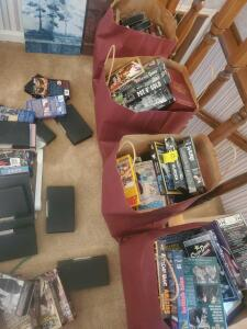 A giant group of vhs tapes! Lots of childrens, westerns, war movies