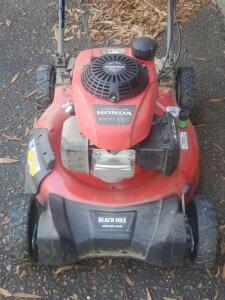 A self-propelled honda lawnmower, less than 2 years old, definitely works