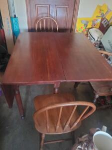 A nice drop leaf table with 4 chairs, 2 are captains chairs, it is missing a support to hold 1 side leaf up.