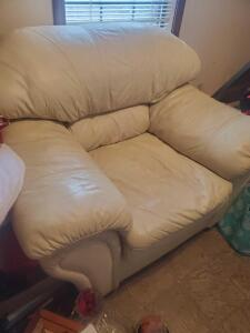 A large very comfy, cream color leather arm chair,