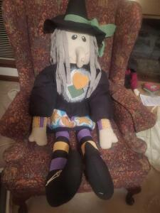 "A life-size stuffed witch halloween decoration, about 60"" tall"