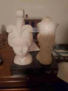 A pair of stone asian figures on a marble like base, they appear to be alabaster