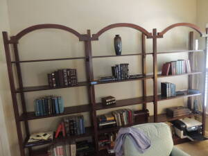 Large Shelving unit.  One Piece, 5 shelves, open back. Shelves are not adjustable; they are fixed in place (i.e. one solid unit)   Dark wood. (content
