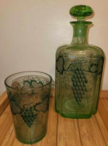 HANDPAINTED GREEN GLASS DECANTER AND MATCHING HANDPAINTED GLASS.