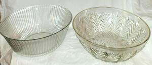 "2 GLASS BOWLS: LEFT 4.5"" X 10"", RIGHT 4"" X 10.5"". NO CHIPS OR CRACKS."