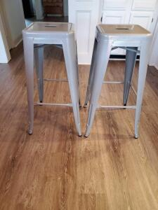 A pair of stacking bar stools - silver color.