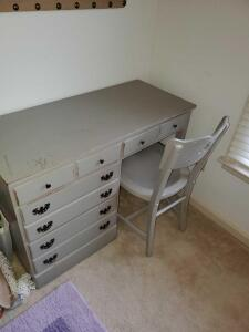 Solid wood 4 drawer desk and chair. Color is grey.