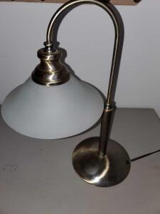 Wonderful desk lamp with glass shade. Antique brass finish. 18 inches tall.