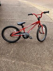 "Boys red 20"" bike by high end maker, Specialized Hotrock."