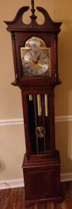 "EMACULATE HOWARD MILLER GRANDFATHER CLOCK 75"" TALL, 16.25"" WIDE, AND 10"" DEEP. NO SCRATCHES OR DINGS."