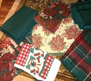 LOT OF CHRISTMAS TABLECLOTHES, PLACEMENTS, NAPKINS, AND TOWELS. VERY NICE.