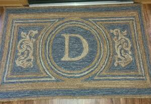"ENTRANCE RUG 47"" X 30"" INITIAL ""D"". GRIPPER STRIPS ATTACHED"