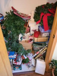 CHRISTMAS GALORE: BOTTOM OF ENTRY CLOSET. SEE PICTURES