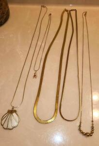 5 GOLD NECKLACES. MARKINGS ARE NOT CLEAR THICKER CHAIN IS 28""