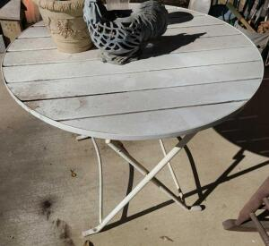"36"" ROUND ALUMINUM FOLDING TABLE 28"" TALL. CONTENTS ON TABLE NOT INCLUDED"