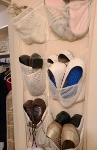 OVER THE DOOR SHOE RACK AND 13 LADIES SIZE 8 SHOES.