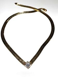 14 karat yellow and white gold herringbone style necklace with a 1.78 carrots round brilliant cut diamond in center