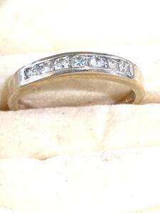 14 karat white gold and seven round full cut diamonds channel band
