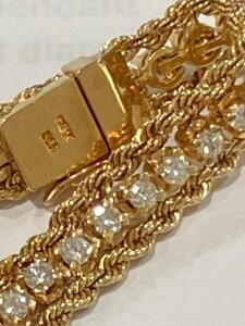 7 inch 14 karat yellow gold and diamond bracelet with rope chain borders, 46 round full cut prong sent Diamonds totaling an estimated 2.30 carats total