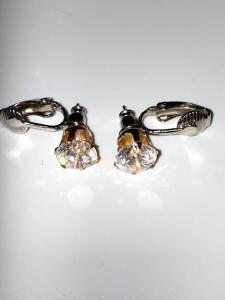 Pair of costume jewelry earrings with clear stone