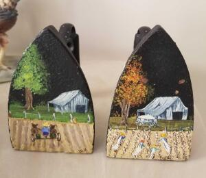 TWO HANDPAINTED CAST IRON SAD IRONS. PAINTED WITH SOUTHERN THEMES.