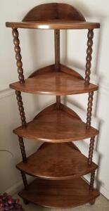 "WOODEN 5 TIER CORNER SHELF 46"" TALL X 21"" AT THE WIDEST AT THE BASE. GREAT PIECE!"