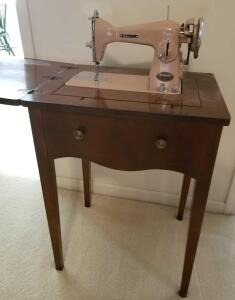 "ANTIQUE NELCO CO SEWING MACHINE IN CABINET. CABINET IS 29"" TALL, 22"" WIDE, 17.5"" DEEP. WITH THE"