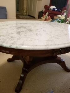 "MARBLE TOP OVAL COFFEE TABLE WOOD CARVED BASE16"" x 34"" x 22"". TOP DETACHES FOR EASE OF MOVING."