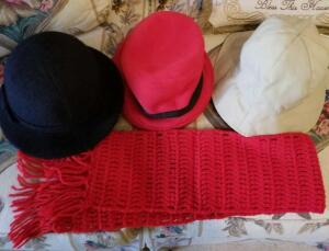 3 LADIES HATS AND A SCARF. ONE HAT IS A RAINHAT AND MAY BE REVERSIBLE TAN AND BLUE.
