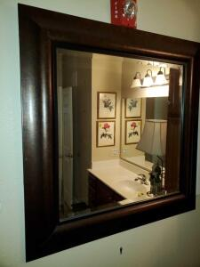 Bevel mirror with rich brown frame. 33 x 33
