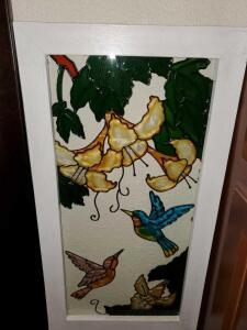 Stain glass look wall hanging with birds. 11 x 21